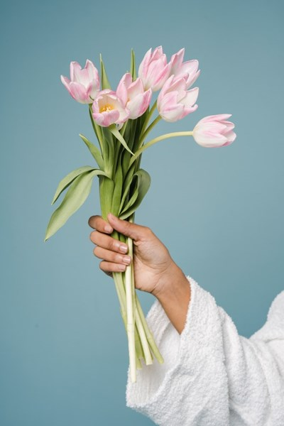 Woman_Holding_Mothers_Day_Bouquet_of_Tulips